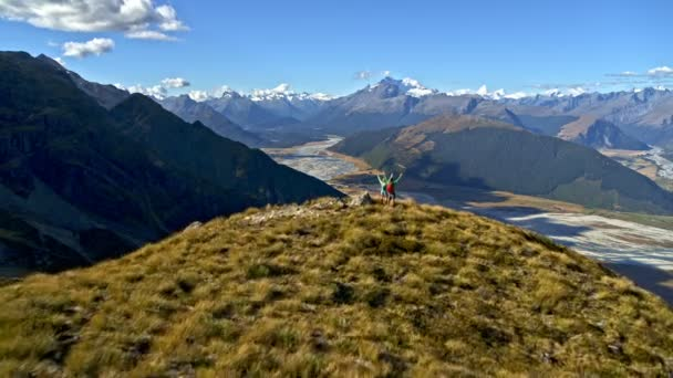 Aerial drone view of young Caucasian adventure hikers achieving their goals trekking Mount Aspiring South Island New Zealand