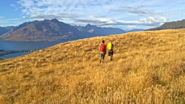 Aerial drone view of young Caucasian adventure hikers enjoying hiking in landscape of Otago Lake Wakatipu New Zealand