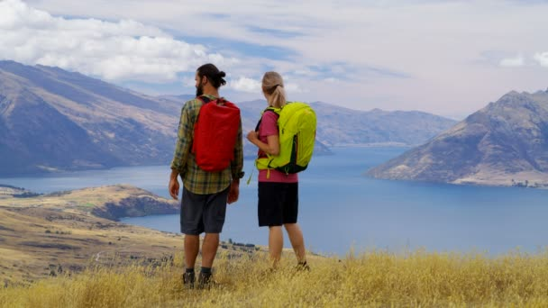 Healthy Caucasian hikers with backpacks on their hiking adventure expedition in Mt Aspiring National Park New Zealand RED WEAPON