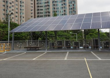 Parking lot with solar panel in Korea and building roof