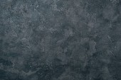 Photo top view of grungy dark concrete wall for background