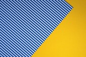 Fényképek top view of blue striped and yellow dotted templates for background