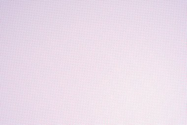 top view of white template with tiny red polka dot pattern for background