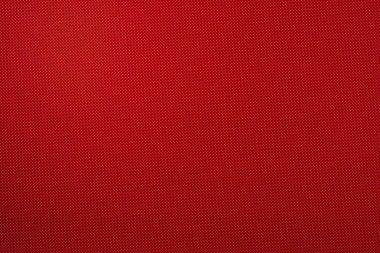 top view of red template with tiny white polka dot pattern for background