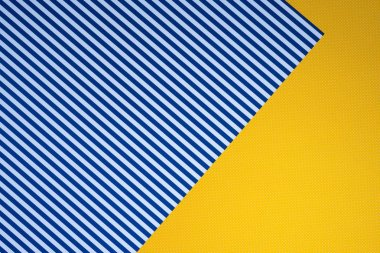 Top view of blue striped and yellow dotted templates for background stock vector