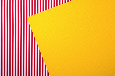 top view of red striped and yellow dotted templates for background