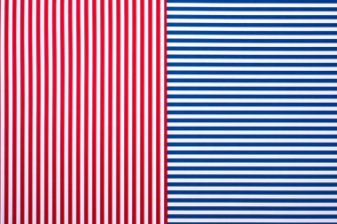 top view of blue and red surface with white stripes for background