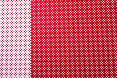 top view of red and white colors abstract composition with polka dot pattern and stripes for background
