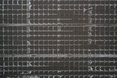 Top view of black plastic grid for background stock vector