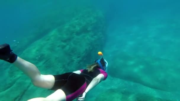 Cute snorkeling girl diving