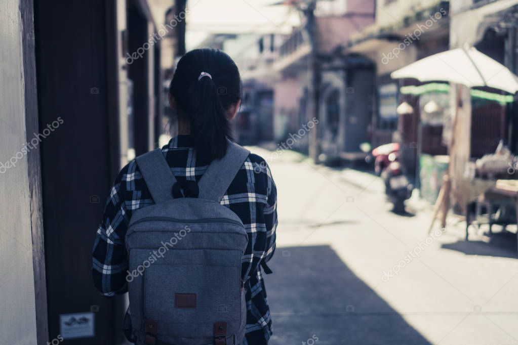 Woman travel around the world with backpack freedom and relax life concept.