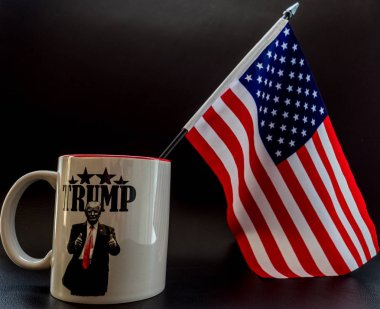trump coffee cup with small america flag in it trump campaign