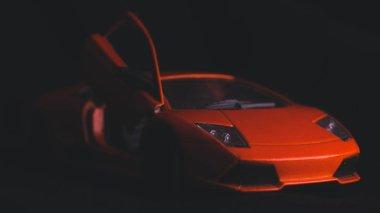 Orange sports car close-up. Macro photography toy cars