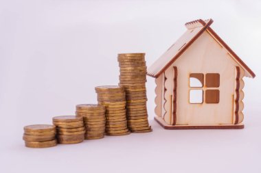 Financial real estate, gold coins and house. Concept: Property investment and house mortgage financial