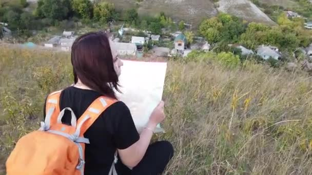 Woman with backpack holding map Traveler traveling alone