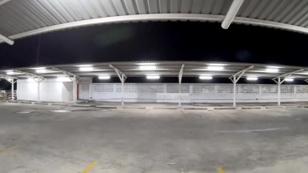 The garage is built from steel and metal sheet  on the parking  at night and bright light.