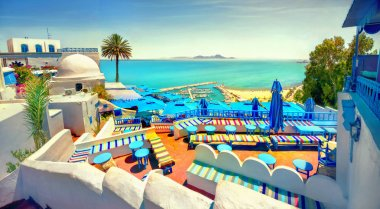 Panoramic view of seaside and cafe terrace in Sidi Bou Said at sunset. Tunisia, North Africa