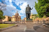 Landscape with bronze statue of Caesar and view of Roman Forum i
