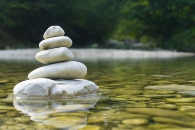 Harmony, balance and simplicity concept. A stone pyramid on the