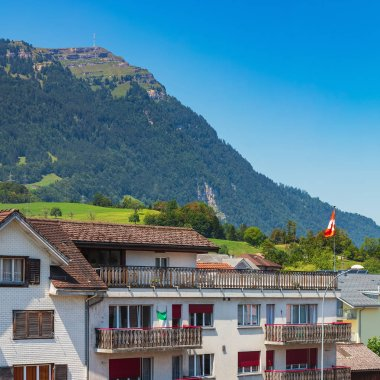 Goldau, Switzerland - July 19, 2018: view in the town of Goldau, summit of Mt. Rigi in the background. Goldau is a town in the Swiss canton of Schwyz, it lies between the Rigi and Rossberg mountains.