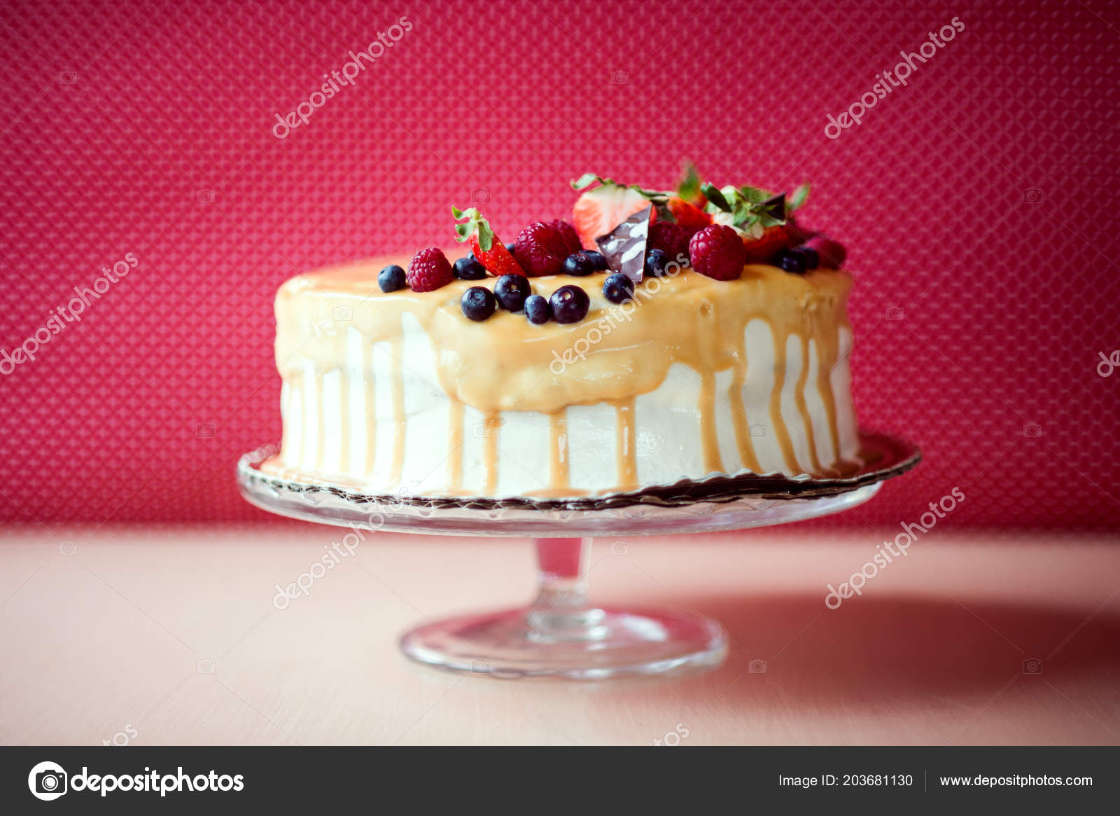 A Birthday Cake On Glass Stand The Table Fruit Top Red Background Photo By Halfpoint