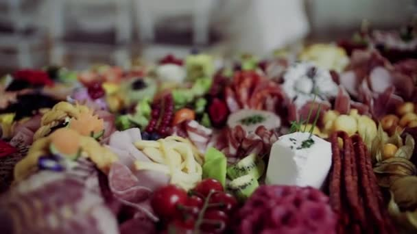 A close-up of various food and snacks on a tray on a indoor party, a cold buffet.