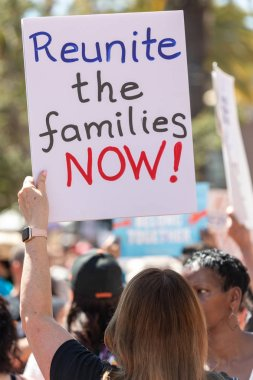 SAN FRANCISCO, CA - JUNE 23, 2018: The Families Belong Together rally, hosted by the Women's March San Francisco. The rally opposed the cruel, inhumane and illegal separation of children from their parents/legal guardians along the U.S. border with M