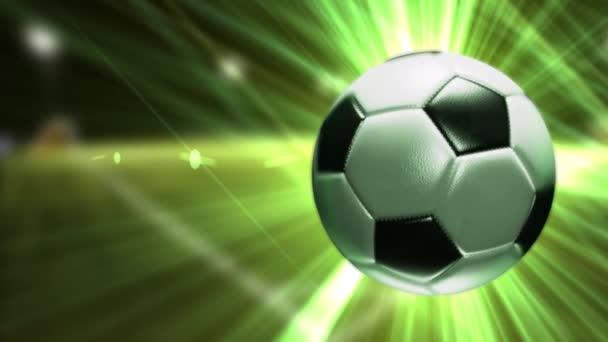 Háttér egy futball-labda. Futball-labda ragyogó zöld sugarak.