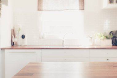 wooden tables with bright blurred kitchen interior background