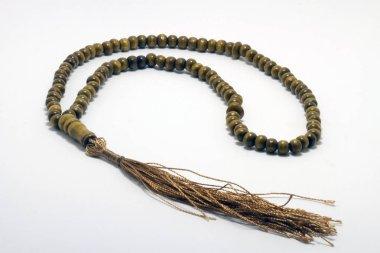 Religious rosary on white ground