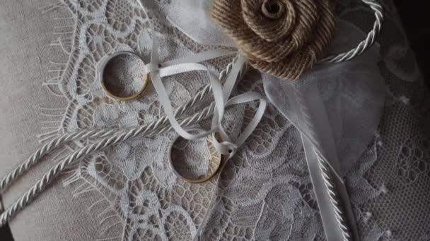 Wedding rings on a white cushion