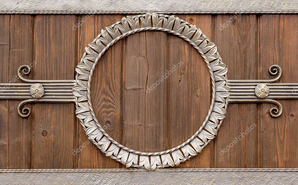 Forged circle on a wooden wall