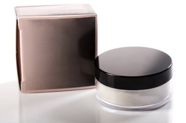 quality powder for a face in a transparent jar with a dark lid and packing photographed on a white background with reflection, isolate