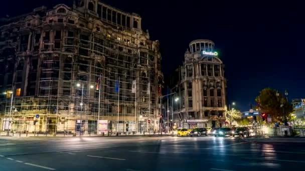 Bucharest, Romania - NOVEMBER 2018: city night traffic and buildings, panning video time lapse 4K. Bucharest, Romania.