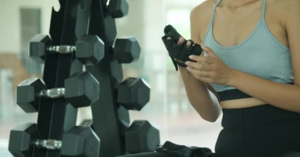 Young asian woman exercising in gym.