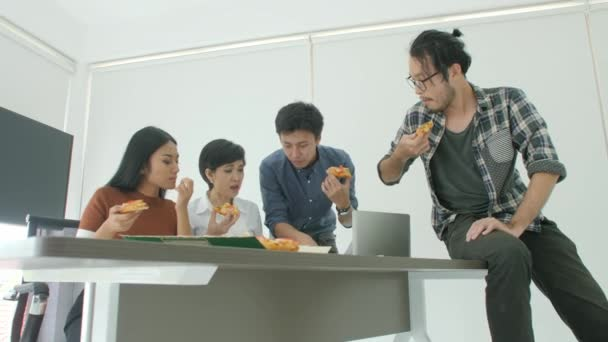Casual Creative Business team having lunch while meeting in office