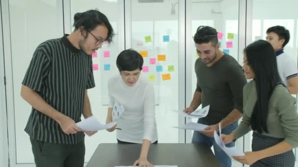 Young business team brainstorming sharing new ideas in modern office.
