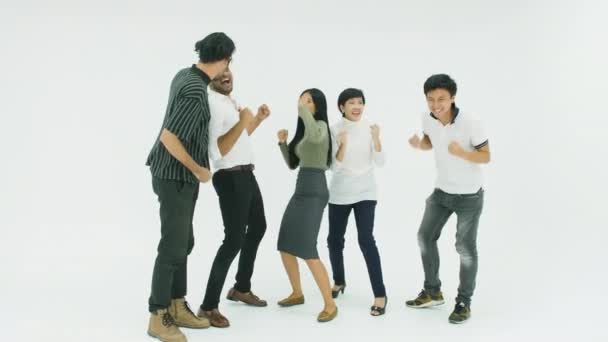 Casual creative business team celebrating their success by dancing