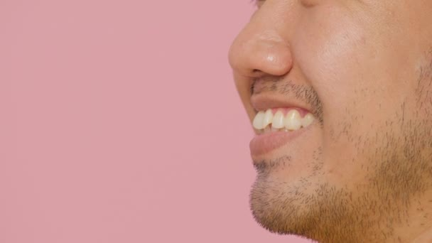 Close up mouth of a laughing young asian man.