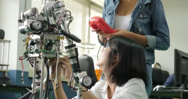 Female Electronics Engineer Building Testing Fixing Robotics In