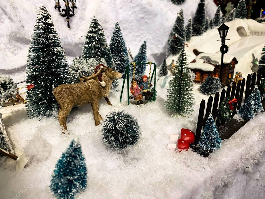 Winter, snow, house, tree. Christmas. Christmas toys.