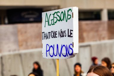 French sign at climate demonstration
