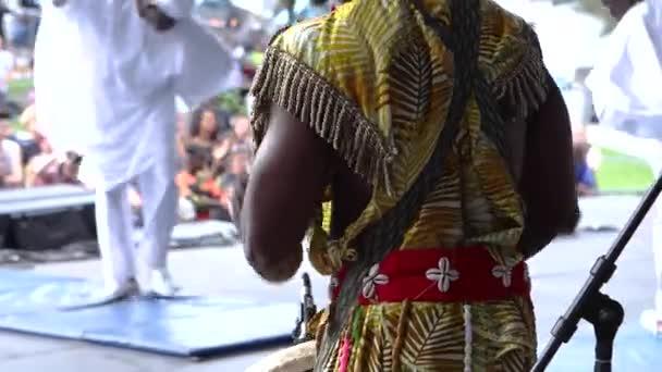 Traditional drummer at cultural concert.