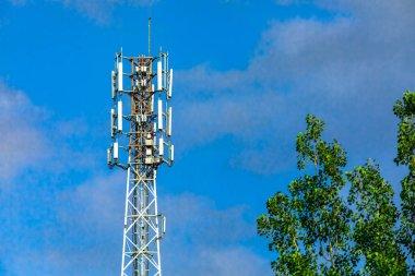 Cellular base station against blue sky.