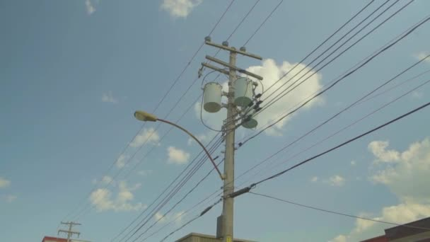 Electric utility pole with electric transformers