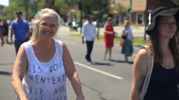 Woman walking with protest text on clothing