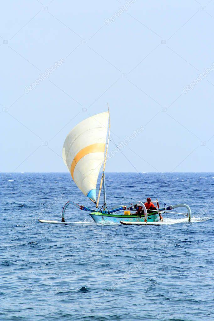 2009.10.11, Ubud, Bali. Fishing boat on the waves. Seascape of Indonesia. Travel around the world.