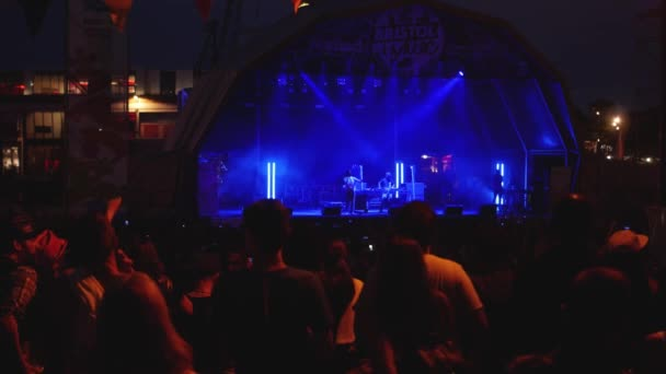 Crowd of People Dancing  Cheering as Stage Lights up at Music Festival