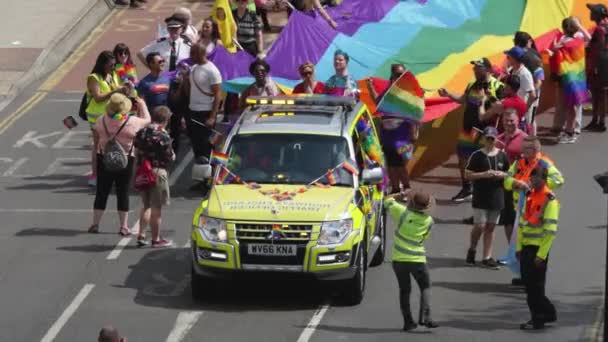 Crowd Marching, Bristol Pride Parade with LGBT Rainbow Flag