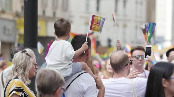 Child on Shoulders with LGBT Rainbow Flag at Bristol Pride Parade